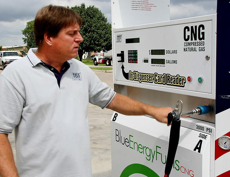 Tom Sewell, President of Tulsa Gas Technologies, demonstrates the Blue Energy Fuels refilling station the company manufactures in East Tulsa.