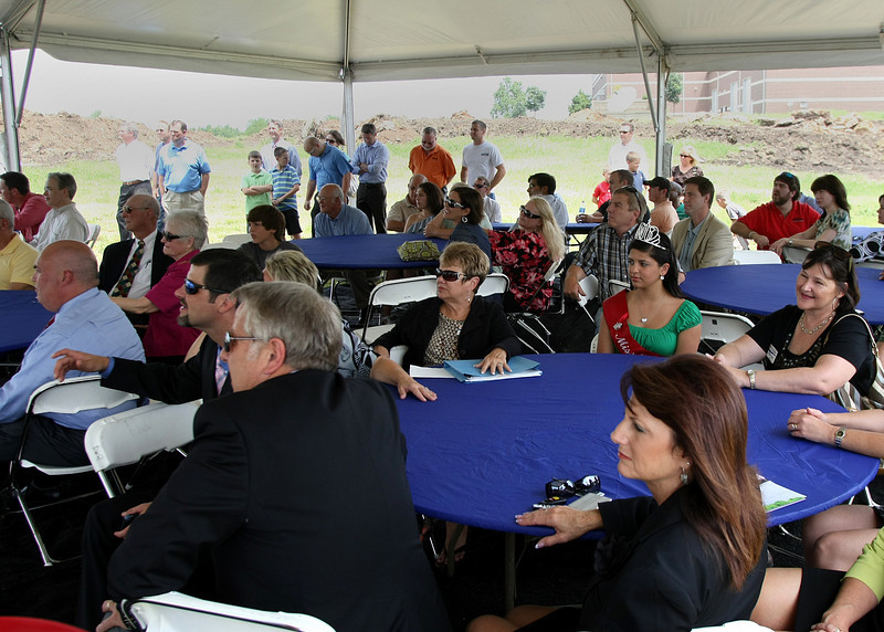 A crowd listens to comments during the ground breaking ceremony for Air Hygiene's new warehouse in Broken Arrow.