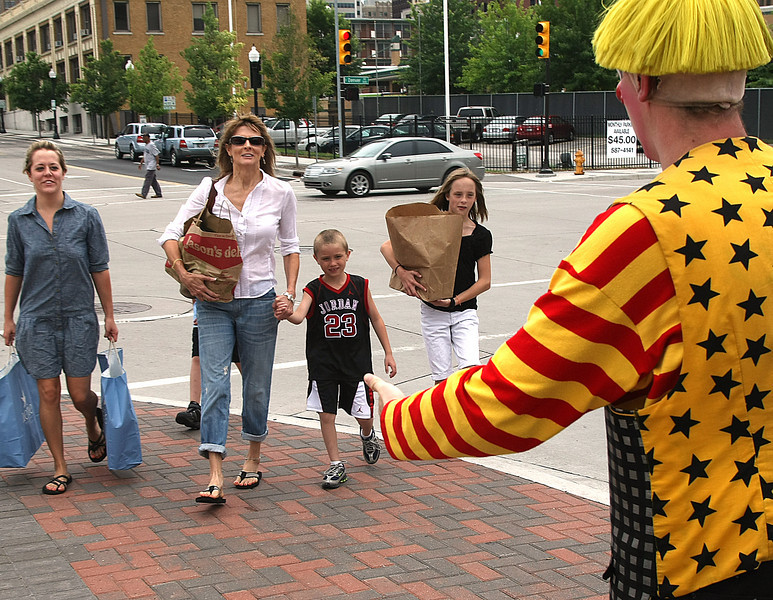 Sarah Mckenna and her family drop off food for the NE Oklahoma Food Bank to Ringling Bros. and Barnum and Bailey circus clowns in downtown Tulsa.  The Circus was providing free tickets to the show for food donations.