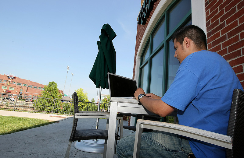 Hector Lopez works on his laptop at the Bricktown Starbucks location Friday. PHOTO BY MAIKE SABOLICH