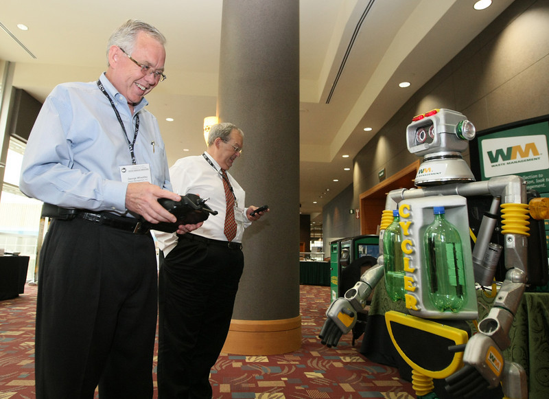 George Wheatley with Waste Management tries out the company robot at the PHOTO BY MAIKE SABOLICH