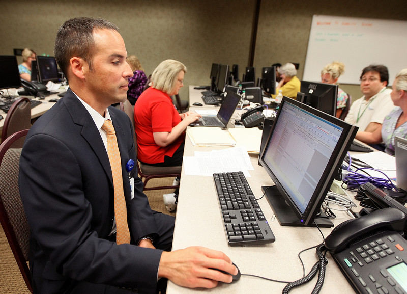 Aaron Steffens, vice president of operations administration at Mercy Health Center, works on the Electronic Health Records system Tuesday. PHOTO BY MAIKE SABOLICH