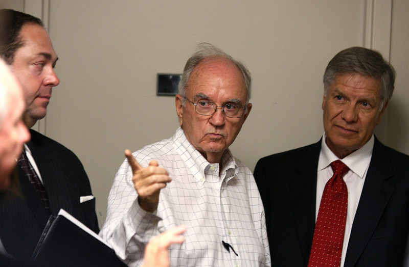 Bob Jackman, consultant from Tulsa, middle, State Senator J. Paul Gumm, left,  Greg Pyle, chief of the choctaw Nation, right, and others plan their strategy to talk to the Water Resources Board Friday. PHOTO BY MAIKE SABOLICH
