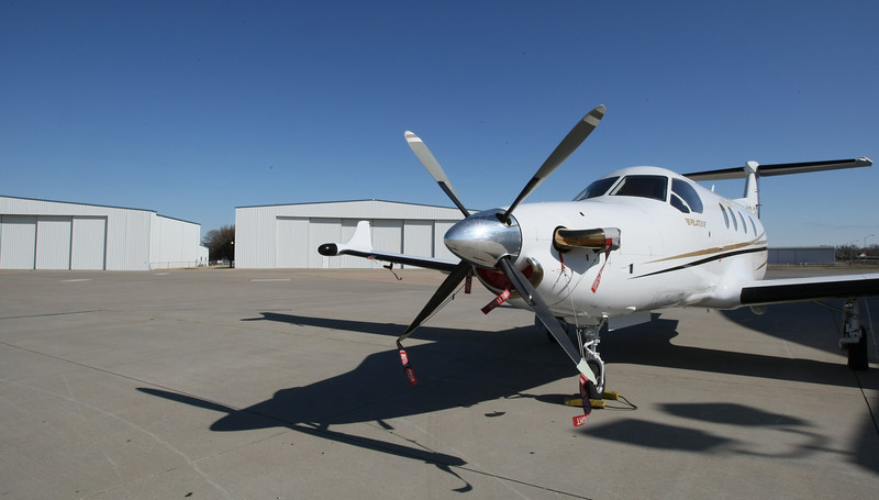 Airplane in front of hangers at Wiley Post Airport. PHOTO BY MAIKE SABOLICH