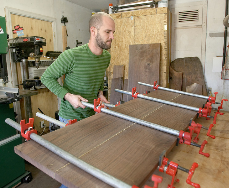 Todd Graham, owner of Tree Theory,works on a project at his shop in Edmond Tuesday. PHOTO BY MAIKE SABOLICH