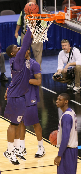 Tyshawn Taylor with Kansas University practices at the Ford Center Wednesday before the 2010 NCAA Division I Men's Basketball First- and Second-Rounds tournaments starting Thursday. PHOTO BY MAIKE SABOLICH