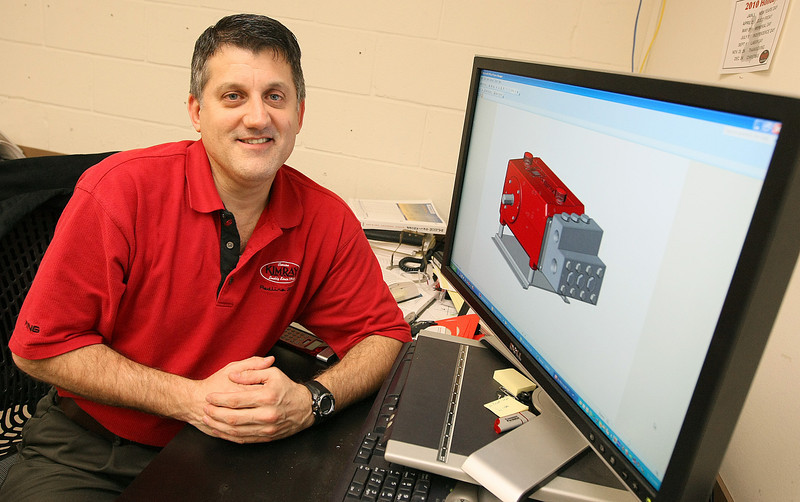 Kevin Gentry, director of engineering for KIMRAY, with an electric glycol pump. PHOTO BY MAIKE SABOLICH