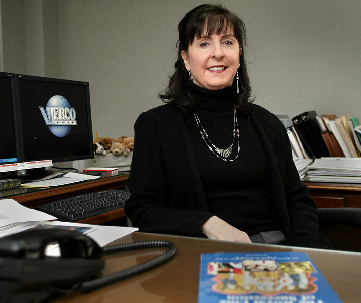 Dana Weber, President of Webco Industries in Sand Springs, pauses for a photo at her desk.