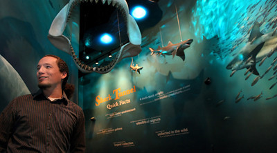 Jenks Aquarium Marketing Coordinator and Graphic Artist Greg Tatum in the newly designed corridors leading into the shark exhibit.