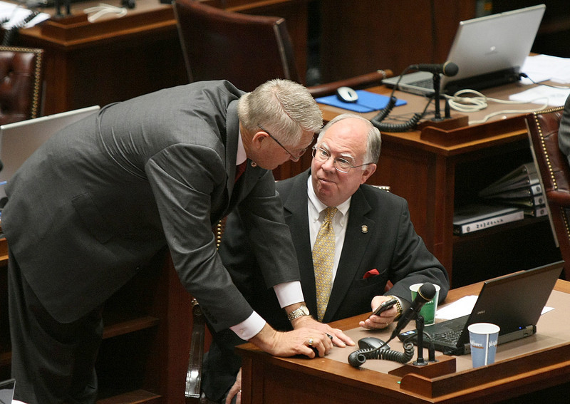 State Senators Mike Schulz and John Ford discuss the content of a message on a mobile device on the Senate floor Thursday. Legislators in two U.S. states are looking at banning lobbyists from texting lawmakers on the floor. PHOTO BY MAIKE SABOLICH