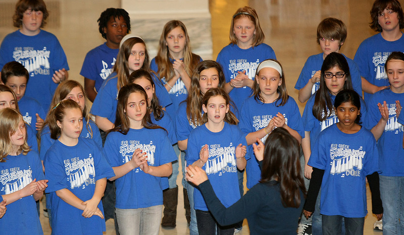 The Deer Creek Elementary School Choir performs patriotic songs at the State Capitol rotunda Thursday. PHOTO BY MAIKE SABOLICH