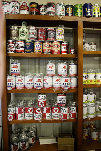 A stack of replica vintage oil cans on the wall at the Gasoline Alley in Broken Arrow.