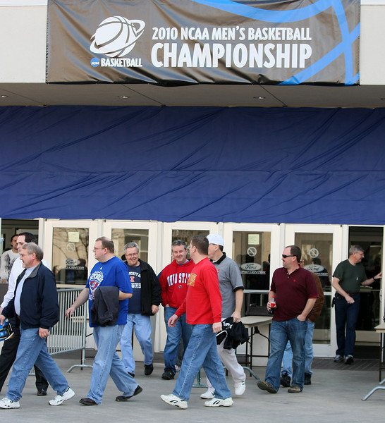 Basketball fans come out of the Ford Center after watching the 2010 NCAA Men's Basketball Championship tournament games Thursday.  PHOTO BY MAIKE SABOLICH