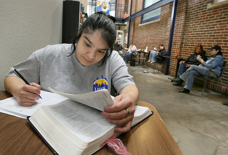 Eva Aguinaga is doing her Bible homework at the City Rescue Mission Friday. PHOTO BY MAIKE SABOLICH