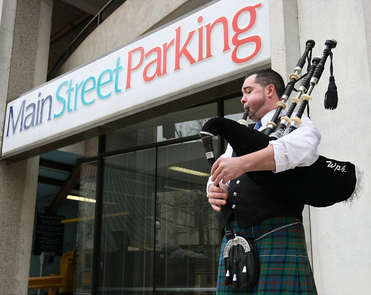 Jesse Bills plays the bagpipes in front of Main Street Parking on St. Patrick's Day Wednesday. PHOTO BY MAIKE SABOLICH