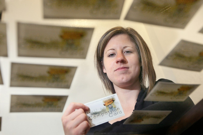 Tiffany Webb, director of development with the City Rescue Mission, with the Compassion Card. PHOTO BY MAIKE SABOLICH