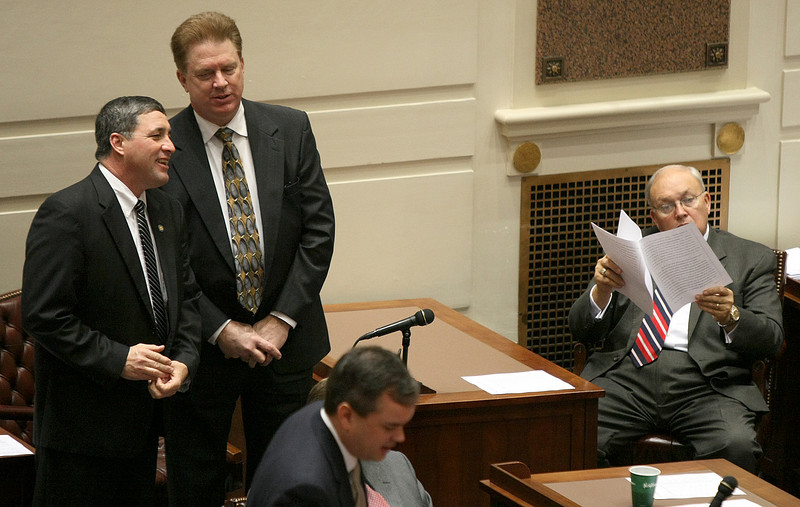State Senator Richard Lerblance, right, studies paperwork on the Senate floor Monday. PHOTO BY MAIKE SABOLICH