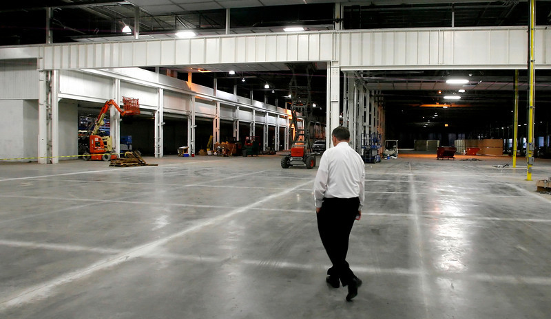Aaon President and Chief Executive Norman H. Asbjornson walks through a small portion of the over 400,000 square feet of new space the company is planning to expand into.