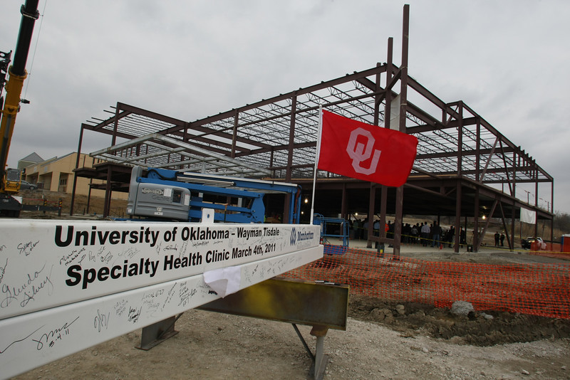 The last steel beam to be installed in the OU School of Medicine's Wayman Tisdale Specialty Health Clinic in North Tulsa.