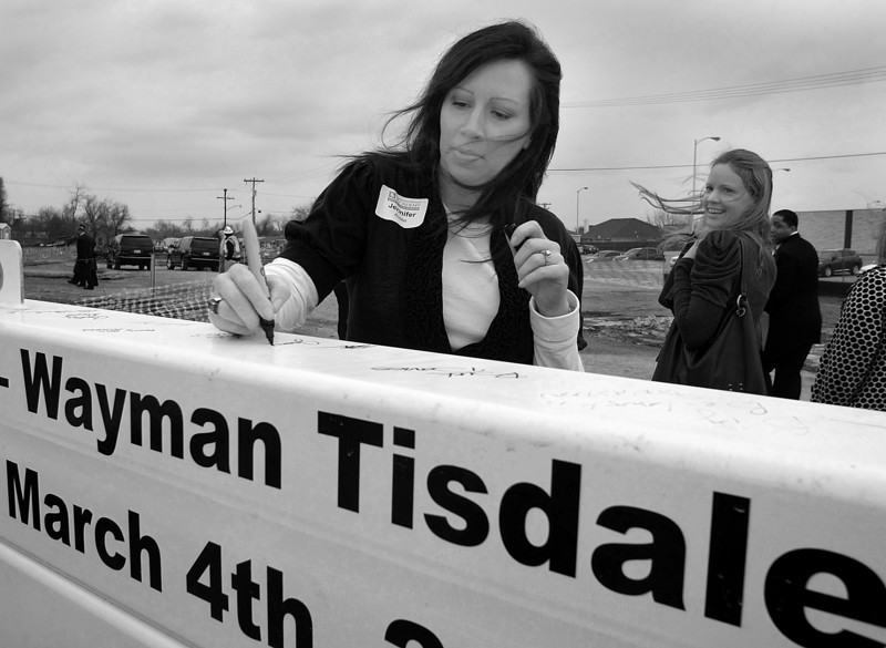Jennifer Austin signs a steel the last steel beam to be installed in the OU School of Medicine's Wayman Tisdale Specialty Health Clinic in North Tulsa.