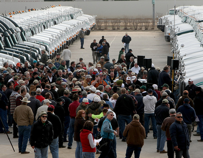The trucks once owned by Arrow Trucking are lined up at the Tulsa fairgrounds to be auctioned off.