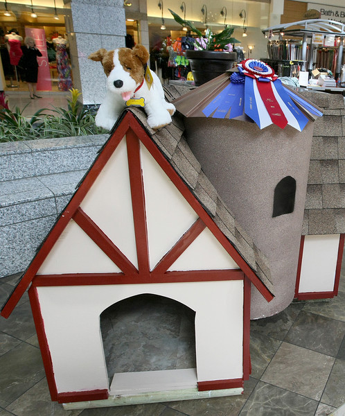 Several local businesses, organizations and individuals built elaborate dog houses such as the pictured castle on display at Penn Square Mall for the Extreme Dog House competition, a fundraising project for the Central Oklahoma Habitat for Humanity. PHOTO BY MAIKE SABOLICH