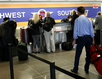 Passengers line up to check in at the Southwest Airline counter in the Tulsa International Airport.