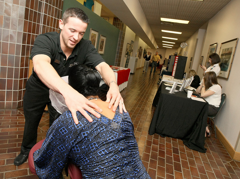 Ryan Noreuil with Massage Envy gives Valerie Nichols a massage during the Spring Into Wellness Conference at Oklahoma City Community College Monday.  PHOTO BY MAIKE SABOLICH