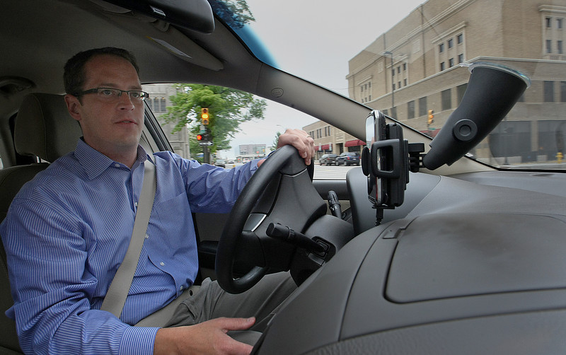 Charles Nesser, Owner on Motolingo, tests the cell phone application his company has designed for fleet services vehicles.