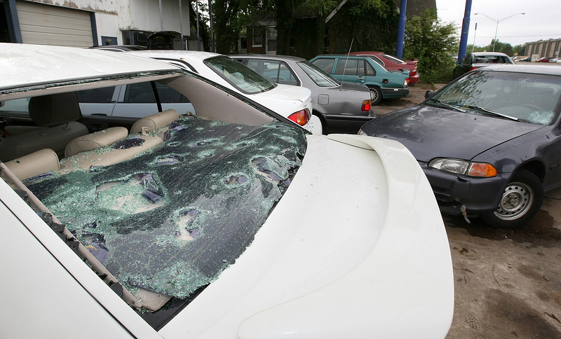 Car windows aere damaged during Sunday's hail storm at a location on Classen Blvd. PHOTO BY MAIKE SABOLICH
