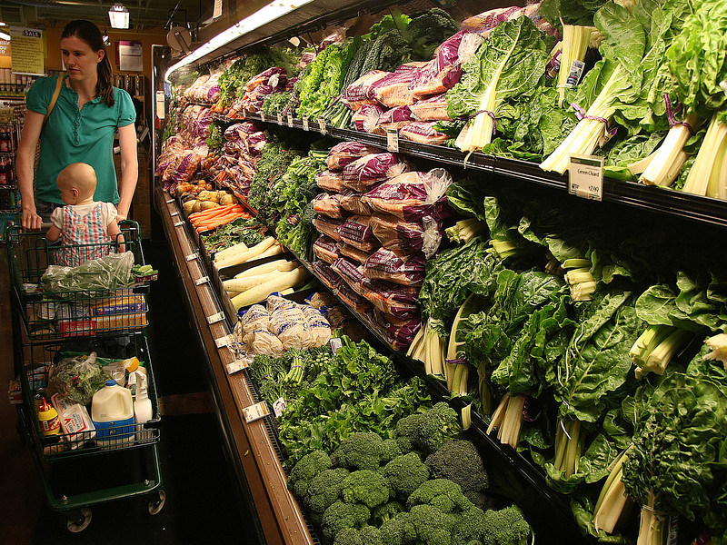 Joanna Buley and Kennedy pick out some vegetables at the Whole Foods market in Tulsa.