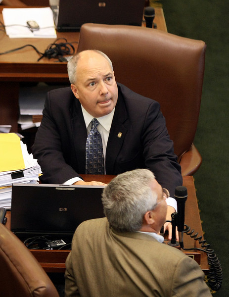 House Rep. Randy Terrill anxiously watches the clock as the end of session approaches Friday. PHOTO BY MAIKE SABOLICH