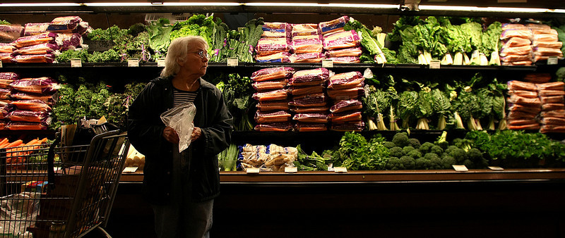 A customer picks out some vegetables at the Whole Foods market in Tulsa.