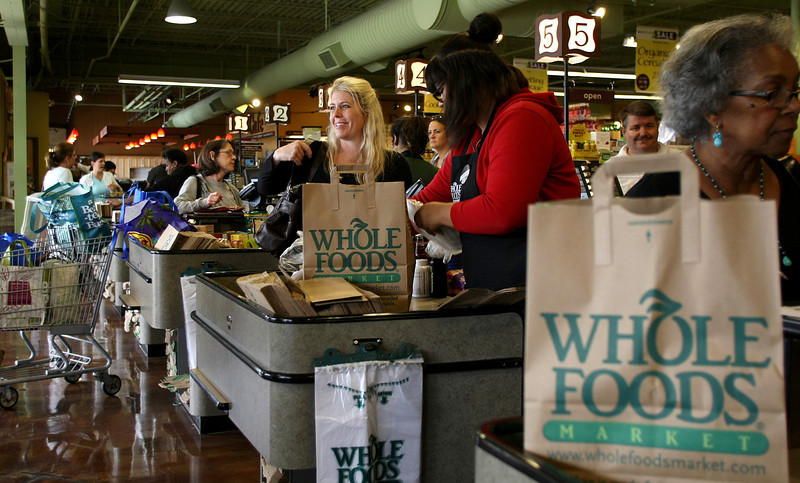 Customers in the check line at the Whole Foods Market in Tulsa.