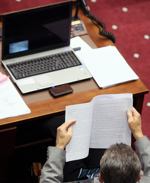 Senator Bill Brown reads a bill during the last day of session Friday. PHOTO BY MAIKE SABOLICH