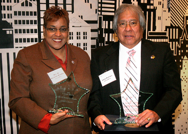Accepting their Tulsa Local Hero Awards from the Tulsa Hospitality & Loging Association are Dr. Reverend Michelle K. T. Moulden and Mr. Larry Ketcher. Photo Courtesy of Tulsa Metro Chamber of Commerce.