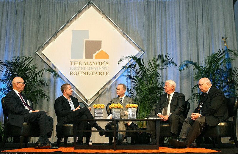 Tom McDaniel, James Ellison, Rick Cain and Keith Jones are Mayor Mick Cornett's panel guests at the Moyor's Development Roundtable event at the Cox Convention Center Wednesday. PHOTO BY MAIKE SABOLICH