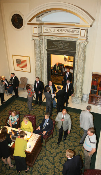 The lobby of the House of Representatibves is busy during the last day of session Friday. PHOTO BY MAIKE SABOLICH
