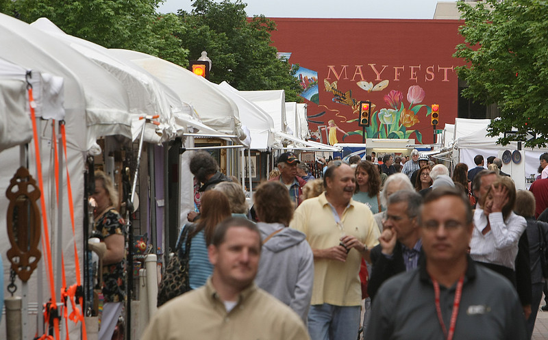 Lunch crowds fills the streets of Mayfest in Downtown Tulsa.