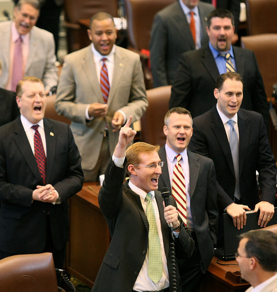 "House of Representatives Majority Floor Leader Tad Jones shouts ""Sine Dies"" to announce the end of session Friday at the State Capitol. PHOTO BY MAIKE SABOLICH"