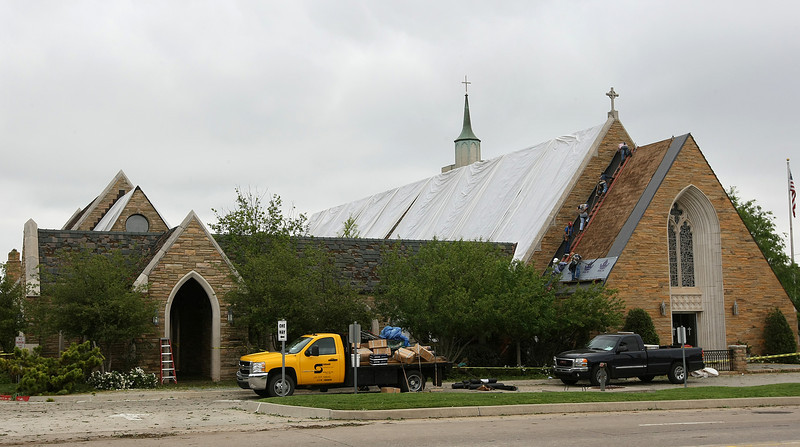 All Souls Episcopal Church suffered severe damage to its roof during Sunday's hail storm. PHOTO BY MAIKE SABOLICH