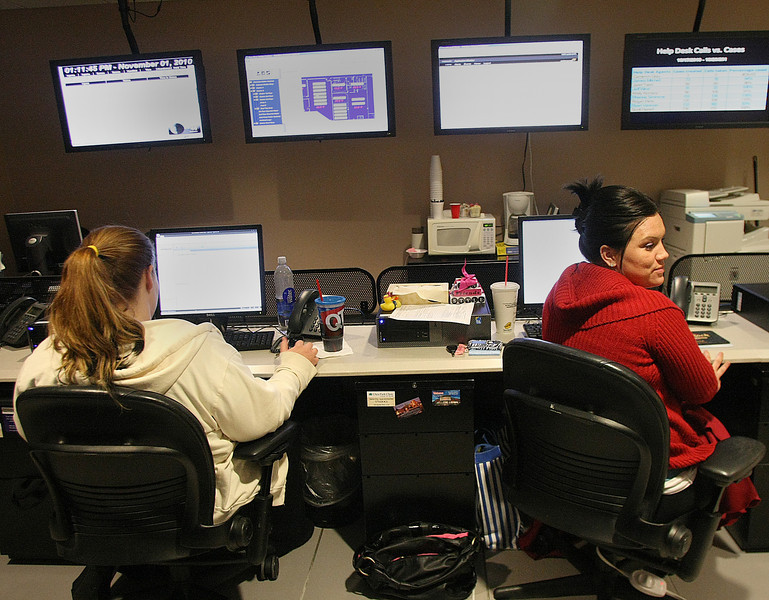 Cherokee Nation Technologies helpdesk employees Ashley Morrison and Jessica Lambert work to correct users issues.