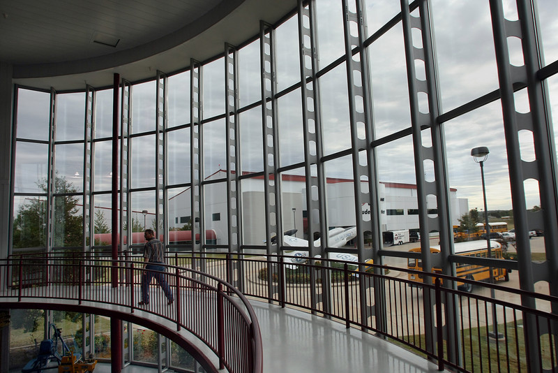 A student walks around the glass front of the main hangar at  the Tulsa Technology Centers main hangar located at the R.L. Jones Airport in Jenks.