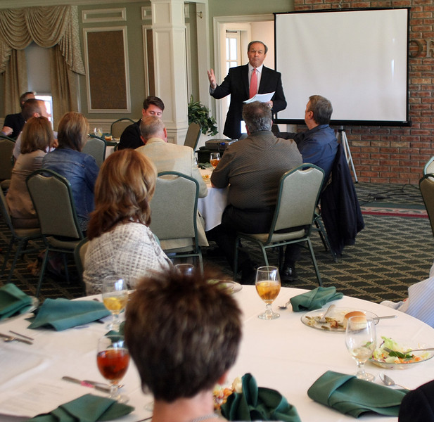 Sam Rader, CEO Colwell Banker Select, gives his presentation at the Tulsa Home Builders Economic Forecast Seminar Thursday.