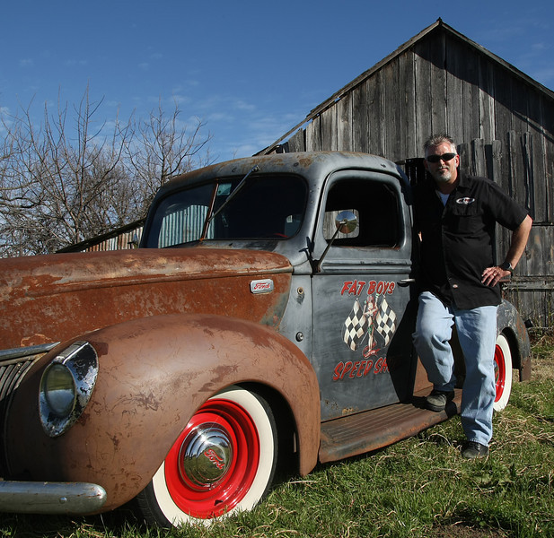 Mike Jones of the Fat Boy Speed Shop poses for a photograph with his newly completed Rat Rod.