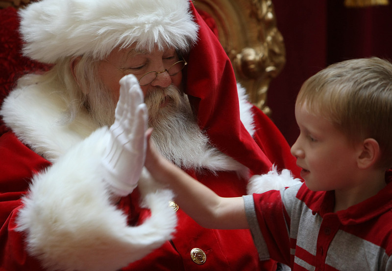 Joseph gets a high five from Santa while getting in some holiday shopping with his mom at Promenade Mall in Tulsa.