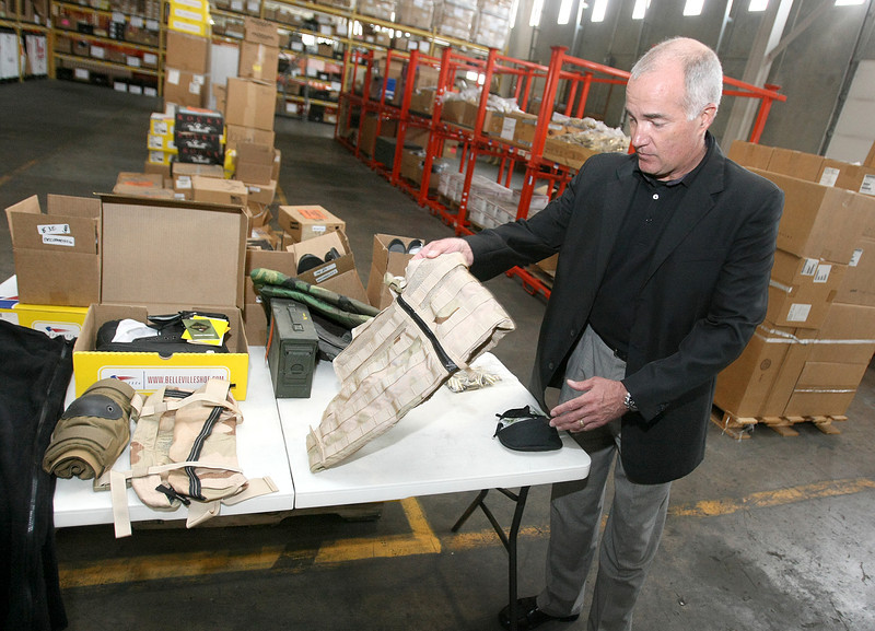 Government Liquidation President Tom Burton shows some of the items in the warehouse Wednesday. PHOTO BY MAIKE SABOLICH