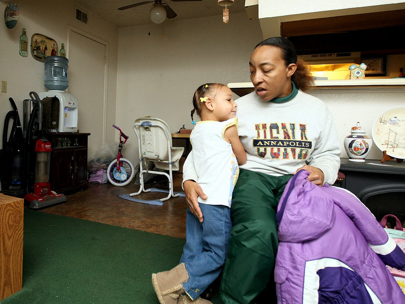 Sheila Herro is getting ready to put a jacket at her four-year-old granddaughter, Arianna Rosewell in their apartment at Twin Lakes Apartments Wednesday. PHOTO BY MAIKE SABOLICH