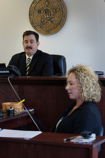 Judge Curtis Johnson and Court Reporter Stacy Davidson in the corporations commissions courtroom in Tulsa.