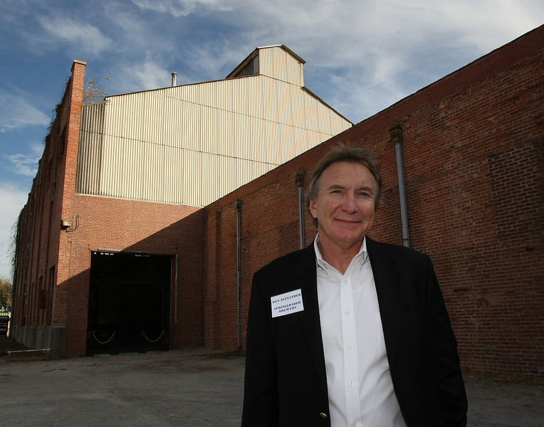 Founder and CEO of the Spring Loaded Brewery, stands outside the old Sand Springs Electrical generation plant that will house the new brewery and restaurant he announced his company is opening.
